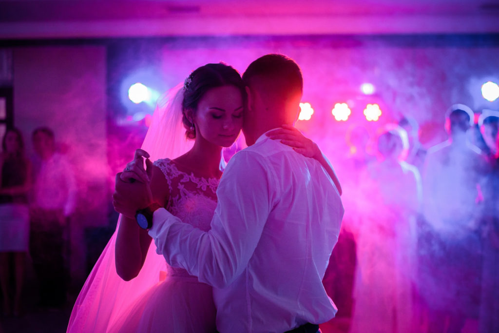 Soft hugs of wedding couple dancing in the first time